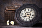 Group of objects on wood table. antique wooden clock , flower, w — Stock Photo