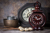 Group of objects on wood table. old clock, antique wooden clock — Stock Photo