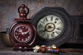 Group of objects on wood table. old clock, hourglass, antique wo — Stock Photo