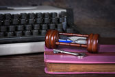 Group of objects on wood table. old book, hourglass, key, type w — Stock Photo