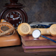 Stethoscope, old telephone, old clock, type writer — Stock Photo #45507035