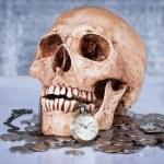 Pocket wach and human skull — Stock Photo #45507955