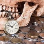 Pocket wach and human skull — Stock Photo #45507971