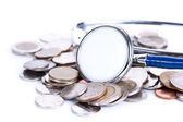 Financial concept, stethoscope  with coins — Stock Photo