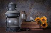 Old rusty kerosene lamp ,old books — Stock Photo