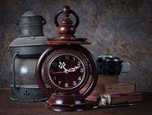 Group of objects on wood table. old clock, old rusty kerosene la — Stock Photo