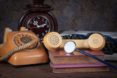 Stethoscope, old telephone, old clock, type writer — Stock Photo