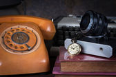 Old watch, old telephone, old camera, type writer — Stock Photo