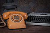 Old telephone, type writer, old rusty kerosene lamp — Photo