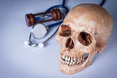 Weathered human skull and stethoscope — Stock Photo