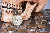 Pocket wach and human skull — Stock Photo