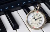 Pocket watch on keyboard — Stock Photo