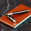 Black pen and notebook — Stock Photo #37334445