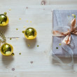 Gold cristmas balls and gift — Stock Photo #37961435