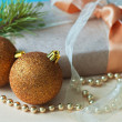 Gold christmas balls and gift — Stock Photo