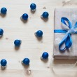 Blue cristmas balls and gift — Stock Photo #37961447