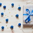 Blue cristmas balls and gift — Stock Photo #37961453
