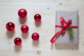 Red christmas ball and gift — Stock Photo