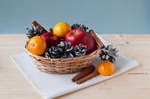 Apples, cones and tangerines — Stock Photo