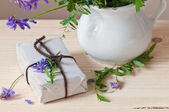 Gift with violet wild flowers — Stok fotoğraf