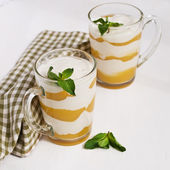 Homemade  cream with peach and mint on white — Stock Photo