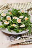 Salad with egg and arugula on green napkin — Stock Photo