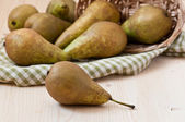Pears with napkin on the wooden table — Stock Photo