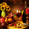 Wine, fruit and nuts still life — Stock Photo