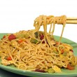 Eating noodles with chopsticks — Stock Photo
