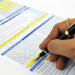 Signing insurance form — Stock Photo