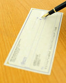 Writing a check — Stock Photo