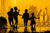 Children playing in water — Stock Photo