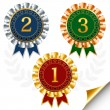Vector set of red, blue and green award badges with silver and g — Stock Vector