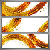 Set of abstract banners with golden brush strokes and splashes. — Stock Vector