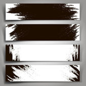 Set of vector black and white banners with brush strokes. — Stock Vector