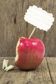 Teeth against red apple — Stock Photo