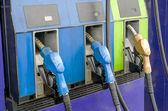 Four petrol pumps, close up — Stock Photo