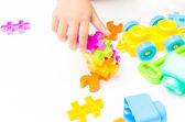 Baby hand playing block toy — Foto Stock