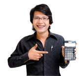 Smile asian business man showing calculator — Stock Photo