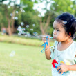 Asian baby girl playing bubble balloon — Stock Photo #46823261