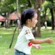 Asian baby girl playing bubble balloon — Stock Photo #46823651