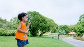 Asian baby girl playing bubble — Foto Stock