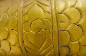 Gold sculpture background — Stock Photo