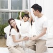 Parents measuring height — Stock Photo #43123391
