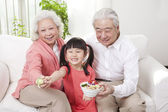 Couple with granddaughter — Stock Photo