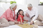 Couple with granddaughter playing — Stock Photo