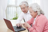 Couple using laptop — Stock Photo