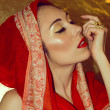 Arabic young woman. Gold makeup. Red clothes. — Stock Photo #37758379
