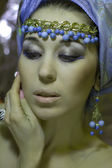 Arab girl in  turban with gold jewelery — Stock Photo