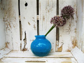 Decoration. Blue vase with decorative bow buds. Design elements  — Photo